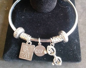 646533c2ac6 Custom made open bangle bracelet. Includes eye chart charm, eyeglasses charm,  personalized charm, spacer and stopper beads.