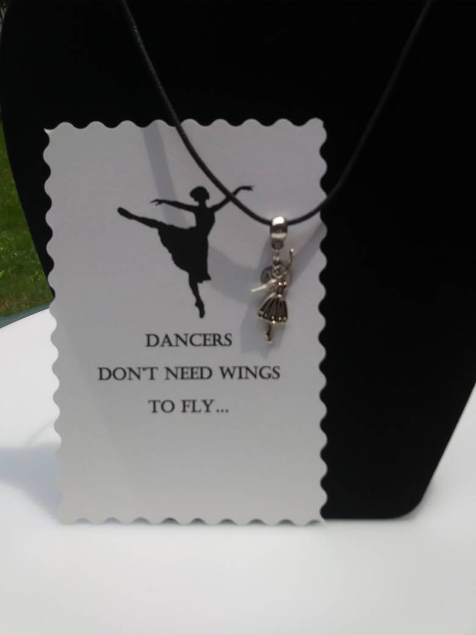 ballet shoes or ballet dancer hung on barrel bead charm holder and hung from silver plated/nickel free ballchain or black cordag
