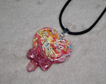 Glittery pink heart lollipop charm necklace with colourful cake sprinkles