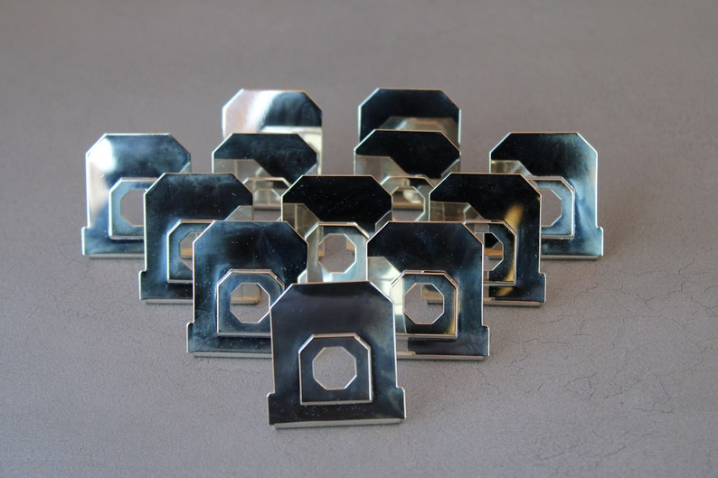 12 silver-plated placeholder mounts