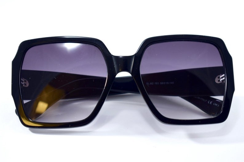 70d7236d30a YSL Saint Laurent iconic sunglasses