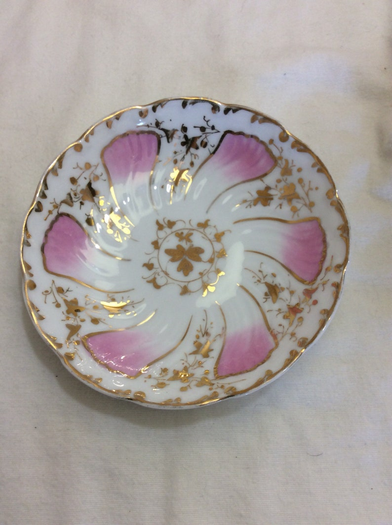 Exquisite pink and white german bowls with gold accents