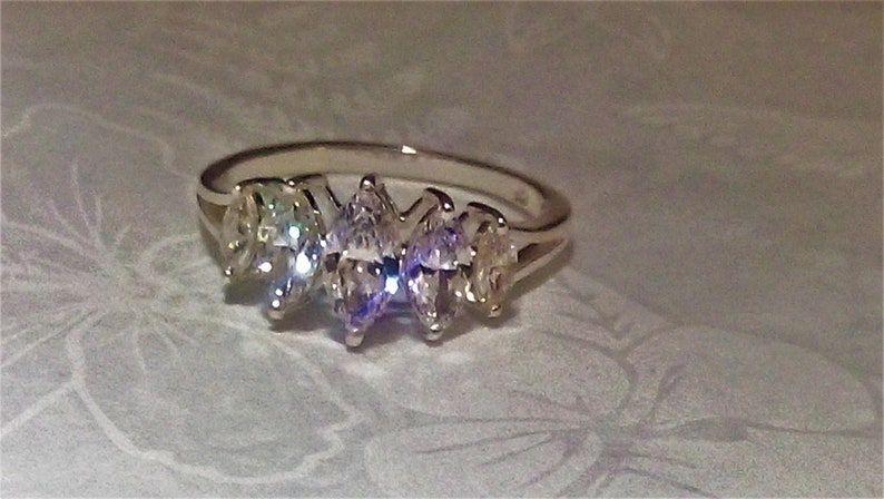 marquise cut stones solid sterling silver diamond ring 2.50 cts gift boxed. excellent clarity and sparkle lab createdsimulated,