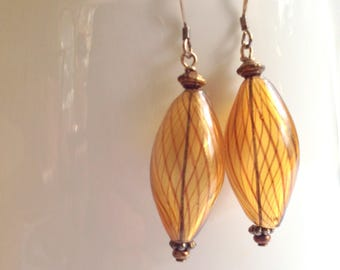Venetian style blown glass earrings in amber colour