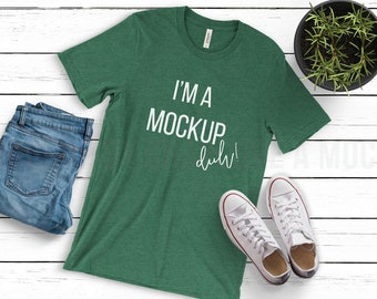 Download Free Bella Canvas 3001 T-Shirt | Heather Grass Green | Unisex Jersey Short Tee | T Shirt Mockup | Feminine FlatLay Mockup | Wooden Clean Mock-Up PSD Template