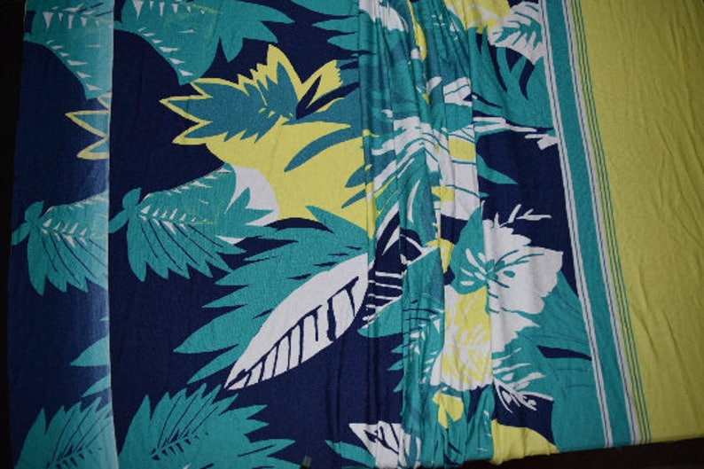 Flower Jersey Knit fabric 1940s inspired 1950s inspired design floral flowers stretchy stretch green tropical hula girl leaves summer yellow