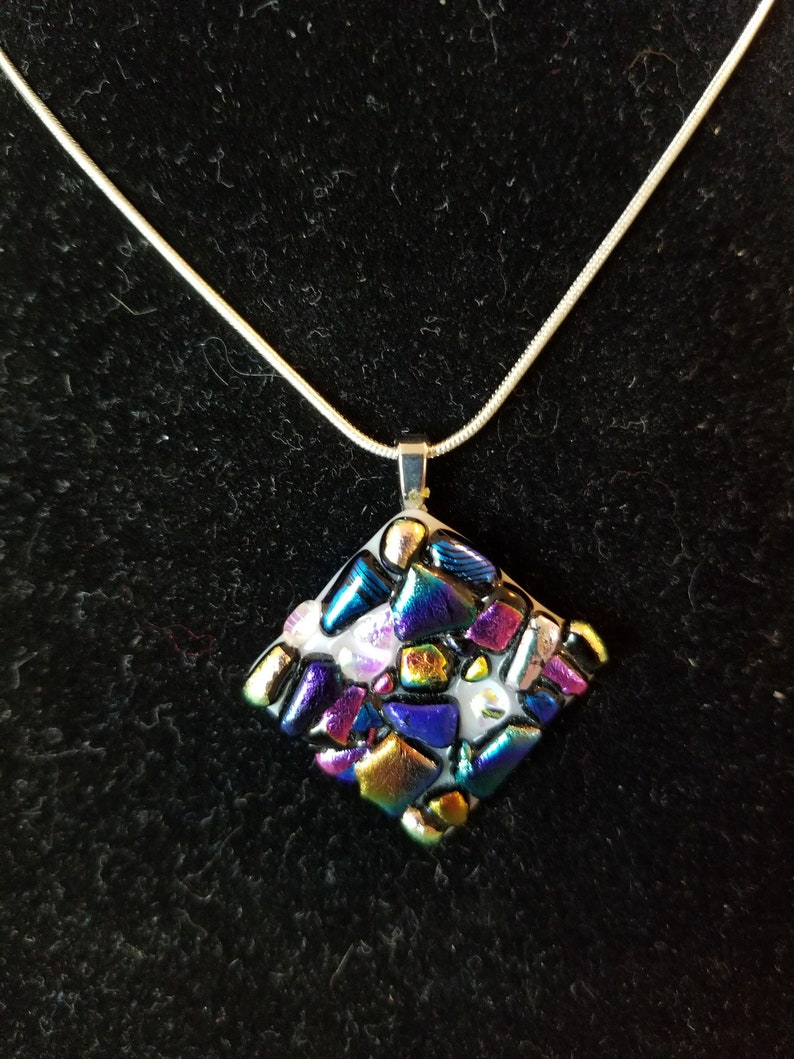 Pendant glass necklace with sparkly dichroic glass pieces.