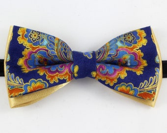 blue and gold patterned bow tie