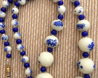 An unusual vintage blue and cream glass bead necklace