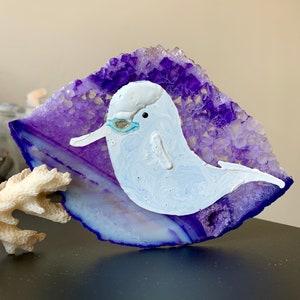 Oil painting on dyed blue druzy quartz agate. Swimming Beluga