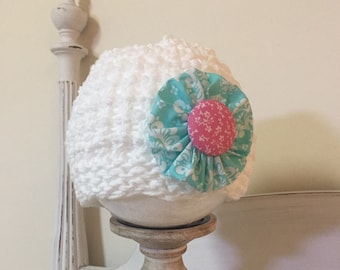 White cotton knit hat with aqua and pink flower for little girls
