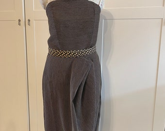 Asymmetric dress with pleat details to skirt