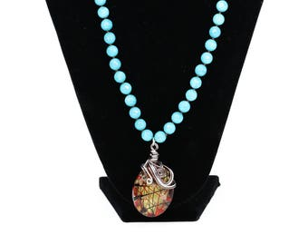 MarcyTreasure Light Blue Jade Knotted Necklace with a Wrapped Wire Pendant