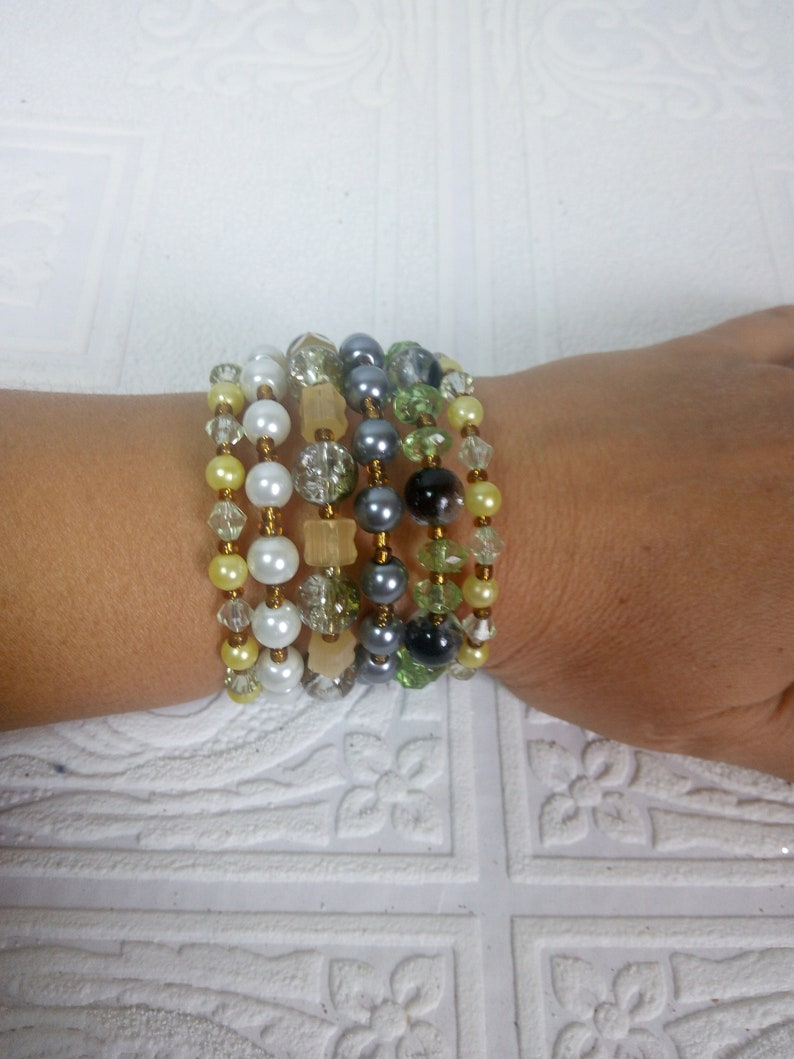 Spiral boho multi-row bracelet for hippies festival and beach party on a wire with a memory of beads and crystals Trend summer 2019