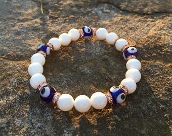 Bluo - EvilEye and Tridacna shell beads bracelet