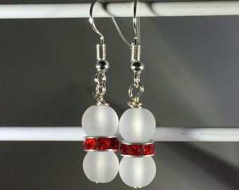 Clear frosted beads (8mm) with red spacer.