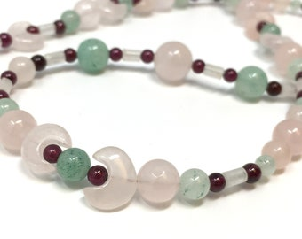 Exquisite, graceful semi-precious gemstone necklace – a quiet symphony of pastels!  Rose quartz, spring green aventurine and ruby red glass.