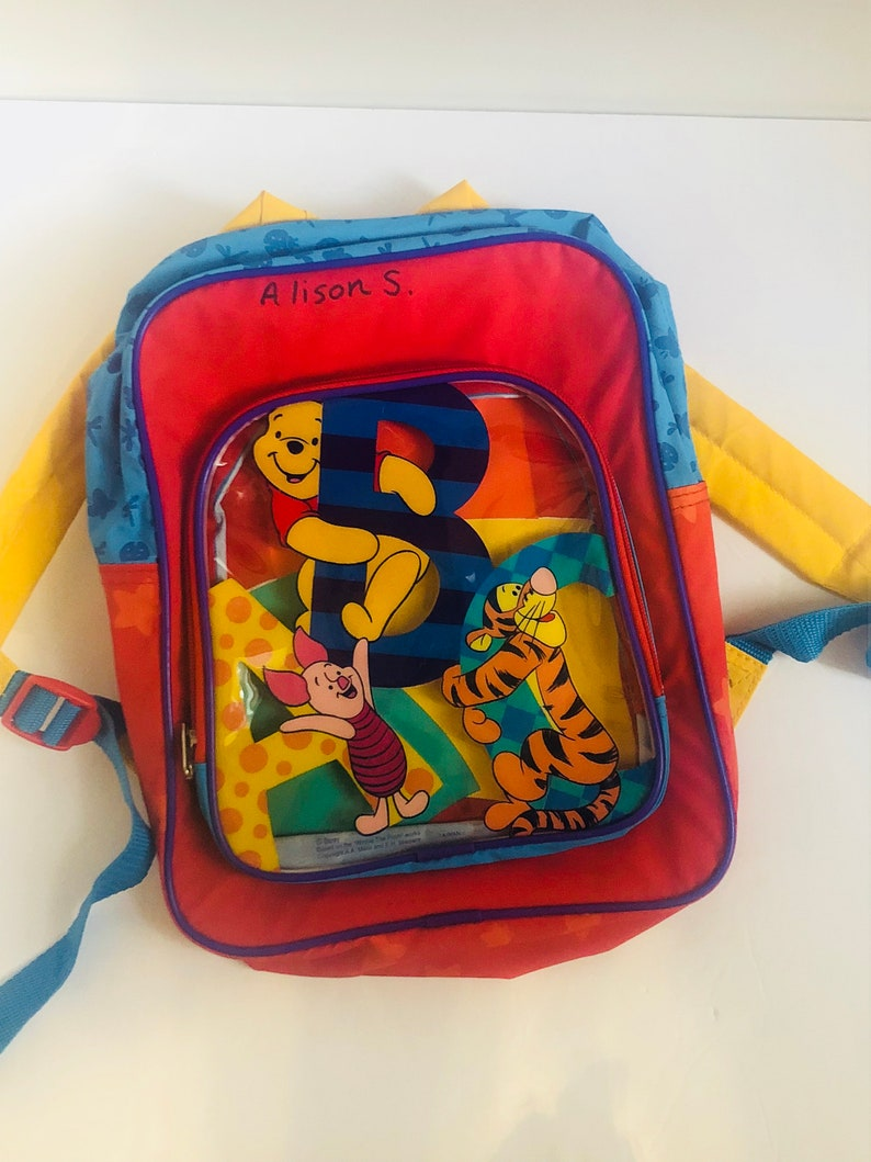 28671641a58c Disneys Winnie the Pooh childrens book bag back pack red