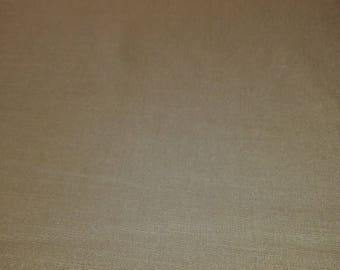 One yard of solid tan linen fabric