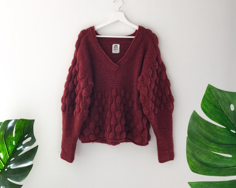 6f9434723e Burgundy pom pom sweater. Oversized knit sweater for women.