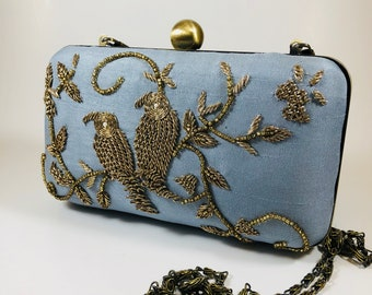 966e1267e6 Blue birds clutch bags