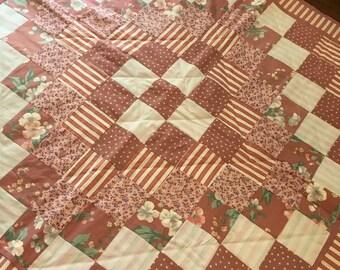 Mauve Homemade lap quilt.