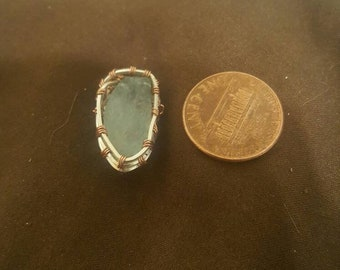 Beautiful Aquamarine stone pendant wrapped in sterling silver