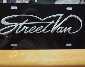 StreetVan logo in silver on black mirror plate