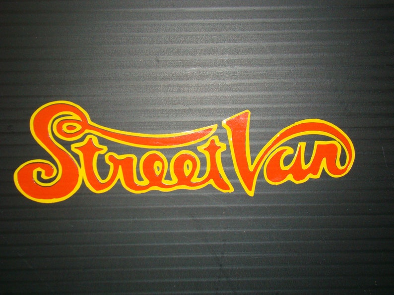 Street Van Logo w/ yellow boarder n orange center image 0