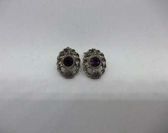 Vintage silver tone earrings with a pretty Amethyst style centre stone. Clip closure. 1960s 1970s era.