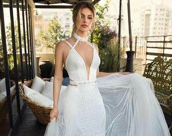 Open white wedding dress with floral embroidery and silk tulle. Stunning dreamy long gown for wedding