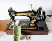 28k Singer Sewing Machine made in 1937, with fold down table, original bell shaped wooden case with key and instruction booklet
