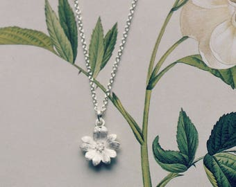 Delicate sterling silver flower pendant