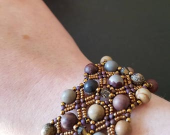Mixed bead woven bracelet with bronze Bali-style clasp