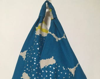 Origami/hobo/market slouch bag with blue splodges and silver triangles.