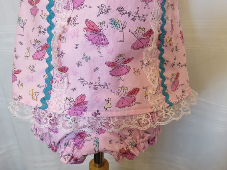 Playful Baby Girl Dress in a Pink Fairy Print with Matching Panties and Hat