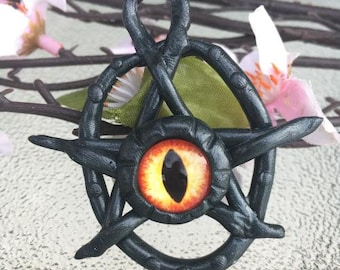 Cute yet creepy eldritch eye charm!