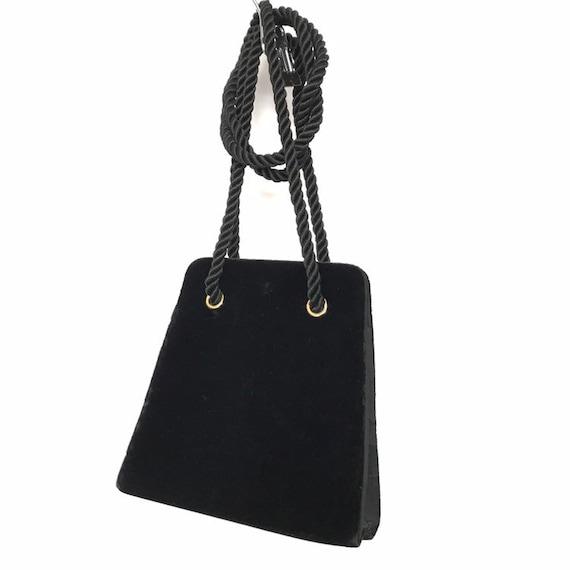 Vintage black velvet handbag with a rope strap by… - image 1