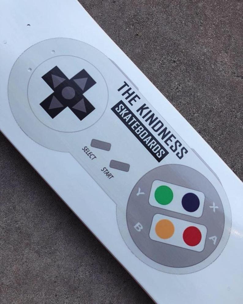 The Kindness Skateboard Co SNES Controller Deck