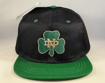 23788c5c425 uk toddler size ncaa notre dame irish vintage snapback hat cap universal  industries navy green new