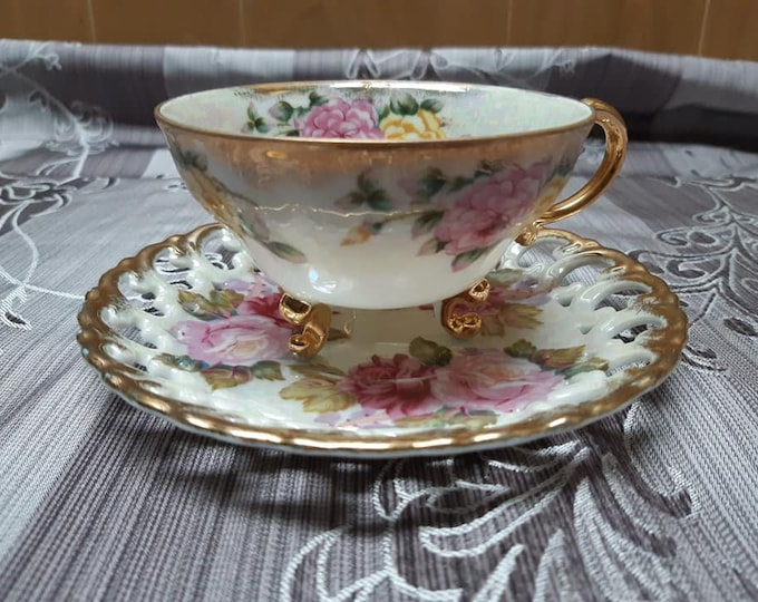 Cup and saucer has 3 foot, fancy Shafford Japan