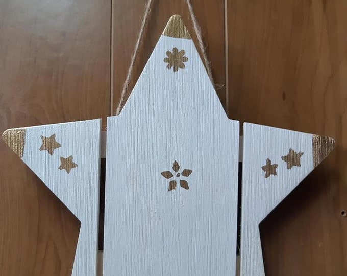 White and gold, wood Christmas decoration star.