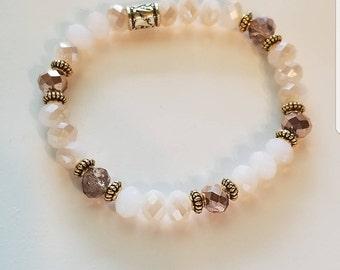 Beaded bracelet. Neutral bracelet. White and rose gold bracelet with  gold accents. Stretchy bracelet