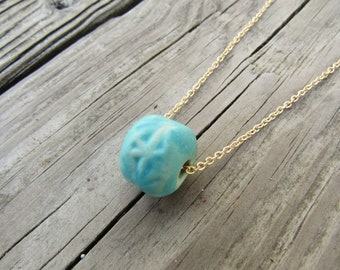 Ceramic turquoise bead necklace with gold chain