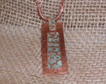 Turquoise patina riveted to etched copper pendant necklace.