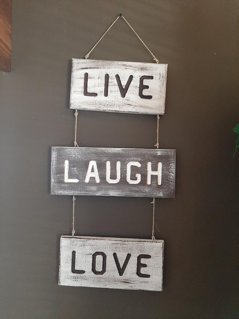 LiveLaughLove wooden hanging sign