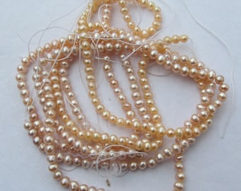 Pearls Freshwater small oval lavender & peach button 3 -15 inch strand
