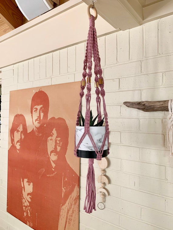 macrame plant hanger in pink with brass accents
