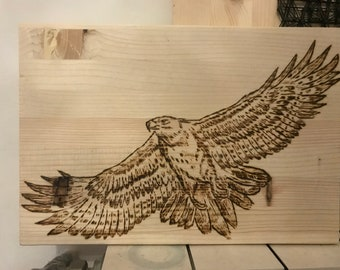 Rapacious pyrography on wood