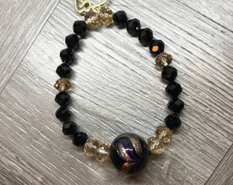 Vintage Swarovski Black Crystal and Venetian Glass stretch bracelet gold tone elephant charm
